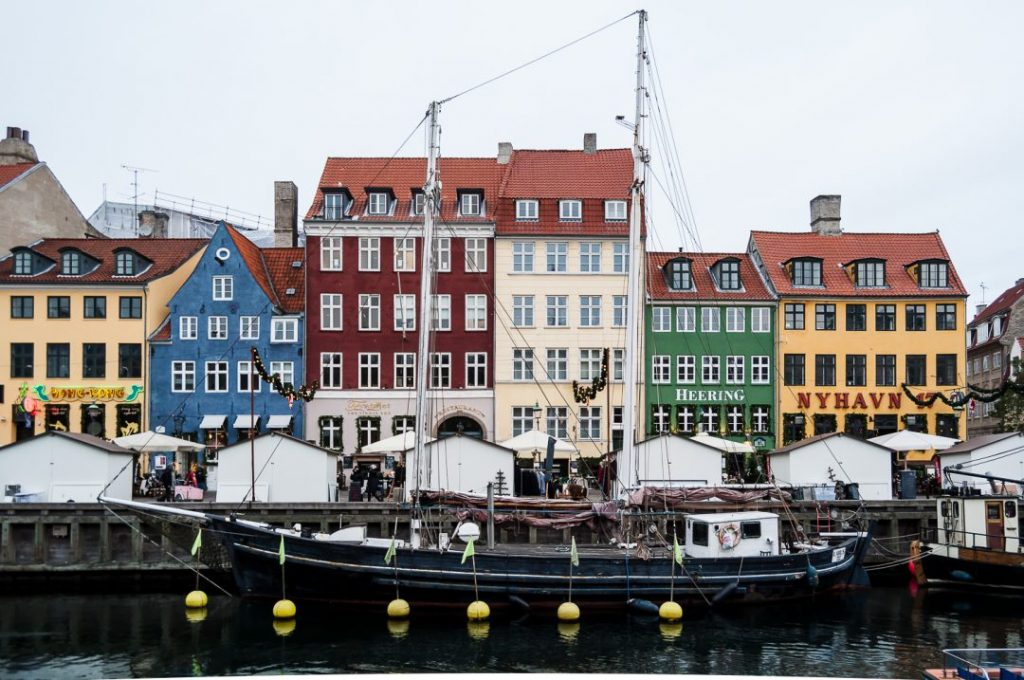 Colourful buildings behind sail boats in the popular Nyhavn hafen in Copenhagen, Denmark