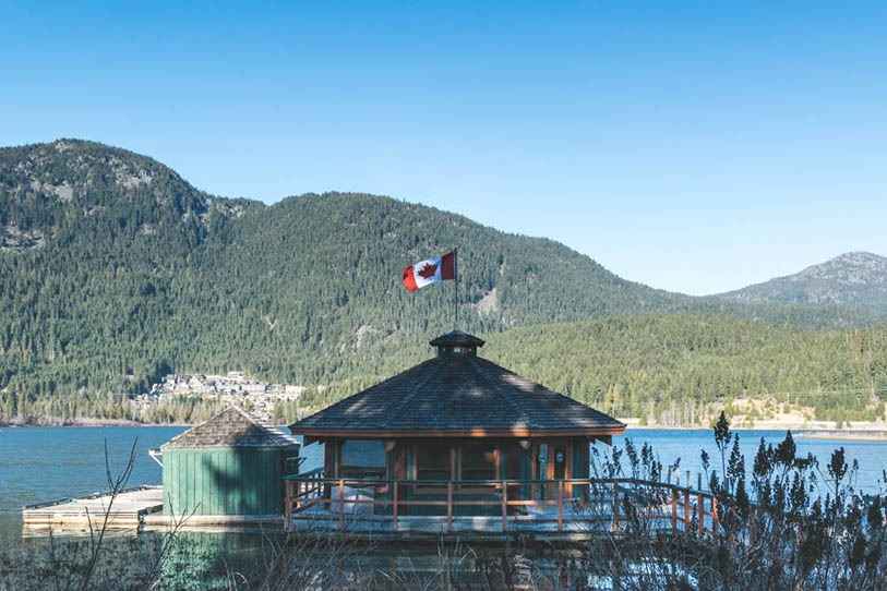 Lake House with a Canadian Flag in Green Lake, Whistler, Canada