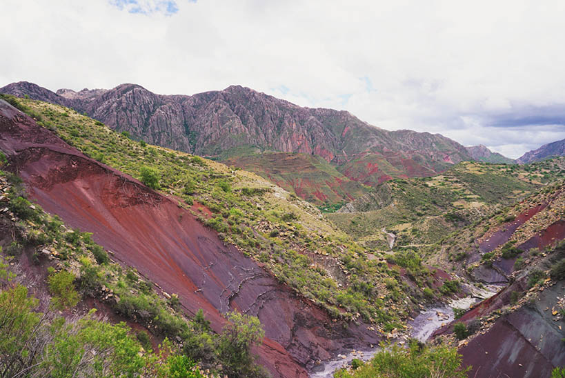 View of the green, yellow and red sediments on the mountain side in Bolivia
