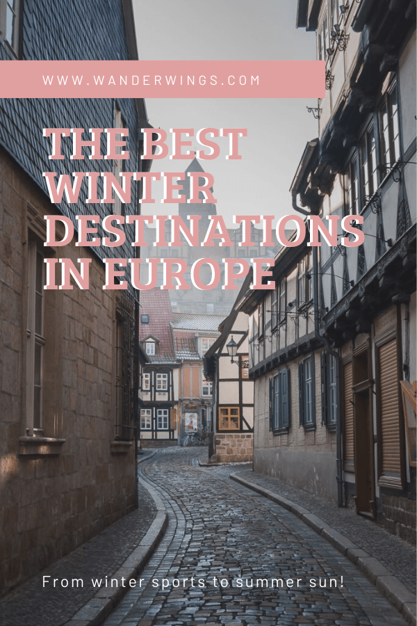 Cobbledstone Street with old timber framed houses and overlay text The best winter destinations in Europe. From winter sports to winter sun.