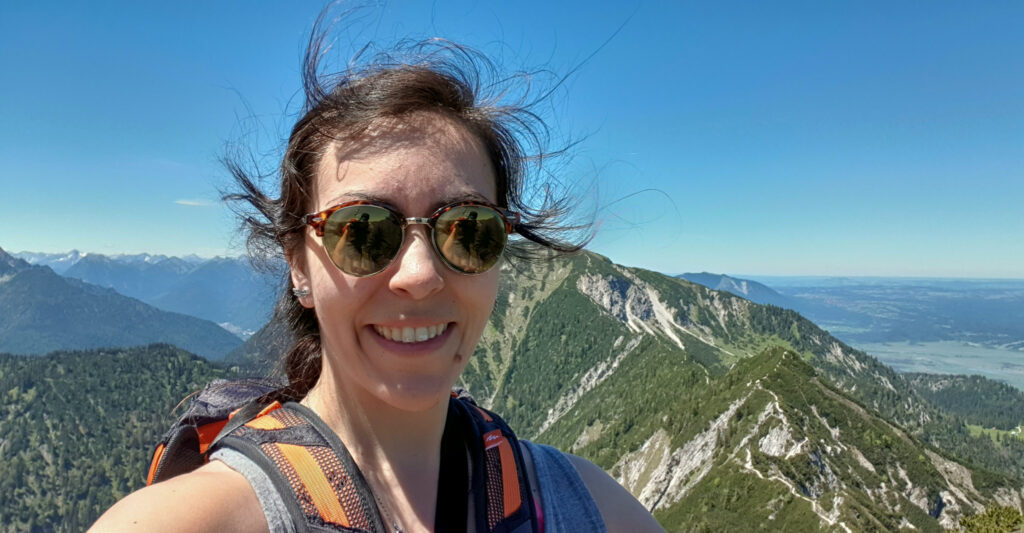 brunette in front of a mountain