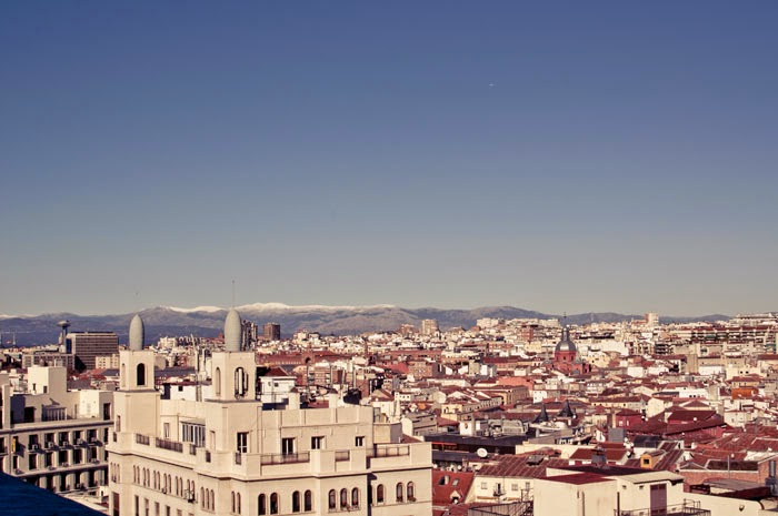 View of the Mountains from the rooftop of a building on a clear sunny day during a weekend in Madrid