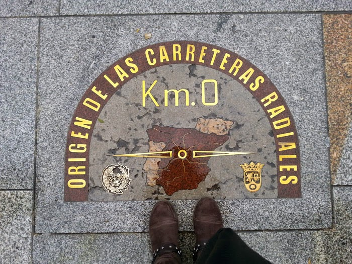 Visiting kilometro cero of Spain, a plaque that signals the start of all roads in Spain, during a weekend in Madrid is a popular activity