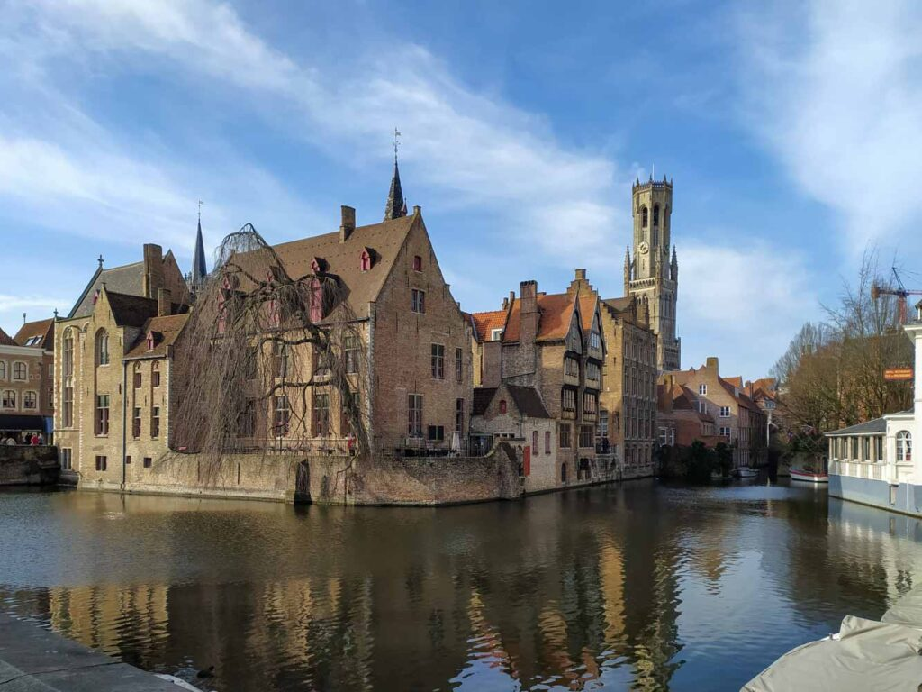 View of a red brick traditional building by the canals in Bruges, Belgium