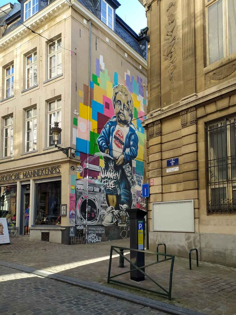 Street art on a wall in Brussels, Belgium depicting the famous local statue of Manneken Pis